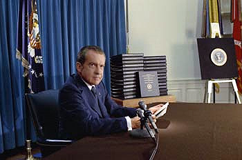 President Nixon, with edited transcripts of Nixon White House Tape conversations during broadcast of his address to the Nation