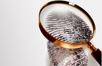 Thumbprint under magnifying glass