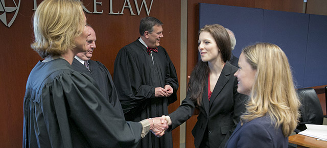 Judge and student shaking hands