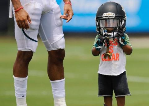 Child wearing football helmet