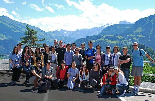 Students from Geneva posing in front of mountains