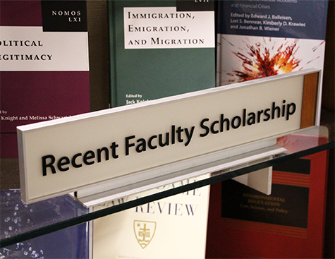 "Image of display case with sign that reads ""Recent Faculty Scholarship."""