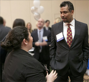 Miguel Eaton '06, an associate at Jones Day, talks to a first-year student.