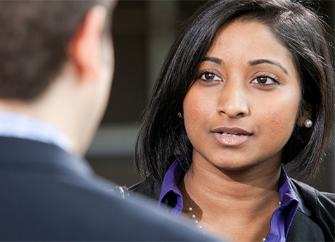 female student speaking in conversation