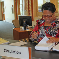 Tina filing at circ desk