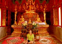 Janan Crocker in front of Buddha in Hong Kong
