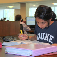 Student in Duke shirt studying