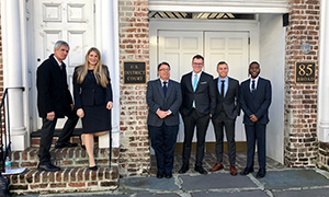 Professor Jeff Powell, director, and Nicole Ligon, supervising attorney, stand with Clinic students Luke Morgan '19, Michael Fisher '19, and Bryant Wright '19 on the steps of the U.S. District Court for the District of South Carolina in Charleston after arguing a motion to dismiss a defamation lawsuit against their client (third from left.)