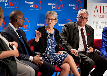 Prof. Carolyn McAllaster participates in a panel discussion on the AIDS epidemic in the U.S.