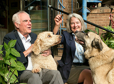 Bill Reppy Jr. and Juliann Tenney '79 with two of their three resuce dogs