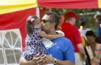 Reunion 2015 picnic, with alum kissing his daughter's painted face.