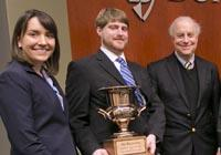 Dean's Cup 2015 winners Logan Mohs '15 and Annie Showalter '16 with Dean David F. Levi