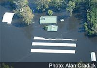 Photo of flooded hog lagoons, courtesy of Alan Cradick