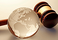 Glass globe with wooden gavel