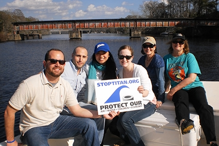 Students posing with sign