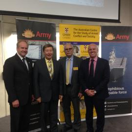 "Professor Dunlap with the organizers of the ""Ethics Under Fire"" conference presented by the Australian Defense Force Academy on June 21-22, in Canberra, AUS."