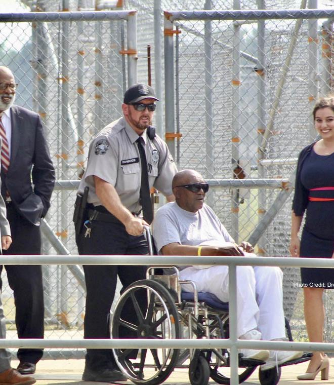 (L-R) Professors Jamie Lau and Jim Coleman and Duke Law graduates Sarah Milkovich '19 and Eileen Ulate '19 smile as Charles Ray Finch is wheeled out of prison