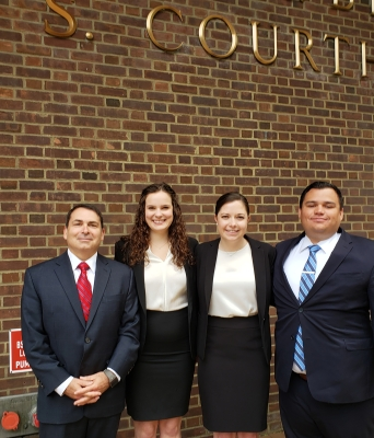 Clinic director and students pose in front of federal courthouse in Philadelphia
