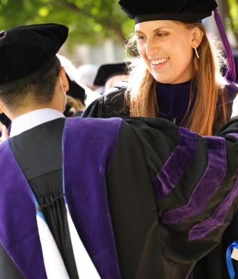 2020 graduates greet each other