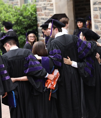Members of the Class of 2019 pose for pictures following their graduation from Duke Law