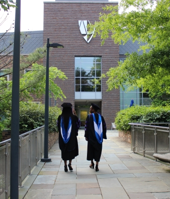Graduates walking toward law school building