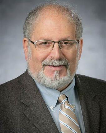 Professor Dennis Simon
