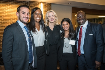 Students and alumnus at reception