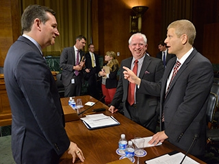 Prof. Neil Siegel, right, chats with Sen. Ted Cruz and Chapman University law professor John Eastman after testifying before the Subcommittee on Oversight, Agency Action, Federal Rights and Federal Courts of the Senate Judiciary Committee on July 22.