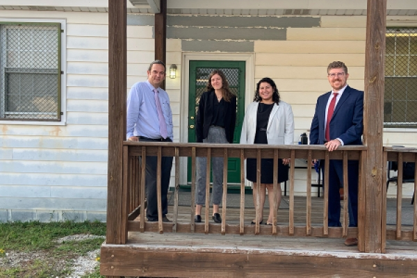 Lawyer Chris Chaney, Kate Weaver '23, Andrea Guzman '22, and Shane Ellison at Fort Pickett