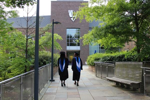 Graduates walking toward law school building